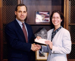 Receiving an award from former FBI Director Louis Freeh