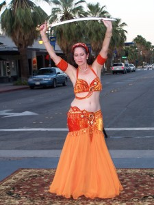 Inara dancing with a sword at Palm Springs VillageFest